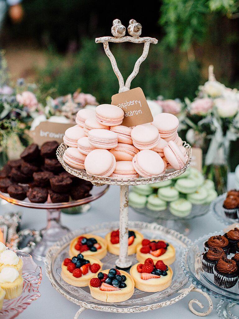 Macaron, fruit tart and mini cupcake dessert station for a wedding reception