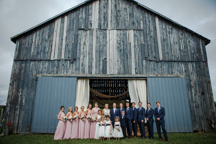 The bridesmaids chose their own style of chiffon dress in Alfred Angelo's Loves First Blush color. The groomsmen dressed in casual navy suits.