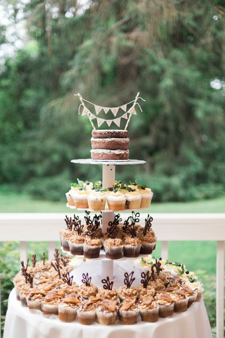 For dessert, Emily and Ben had a small Oreo naked cake at the top of a tiered stand that featured German chocolate cupcakes, lemon poppyseed cupcakes with blueberry compote and Nutella-filled banana cupcakes with peanut butter frosting.