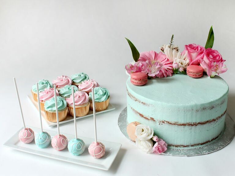 One-tier blue bridal shower cake with cupcakes and cake pops