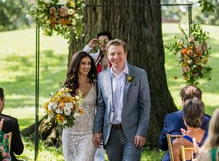 """Gia Rodriguez and Kurt Knisely celebrated their love with a ceremony beneath an arch with minimal flower arrangements at Schiller Park. """"We both love"""