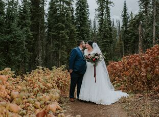 The stunning scenery took center stage at ChristinaParsons and Adam Galvine's rustic fall wedding. Their venue, Emerald Lake Lodge in British Columbi
