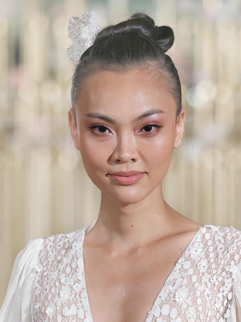Top knot wedding hairstyle for long or medium hair