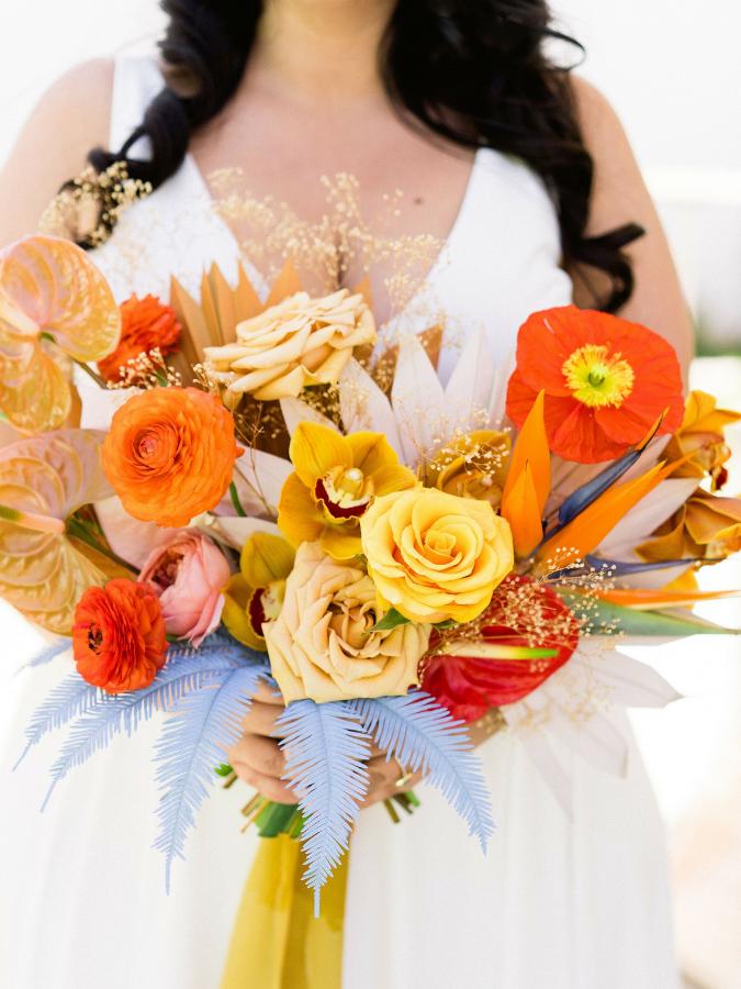 Orange bouquet with blue accents