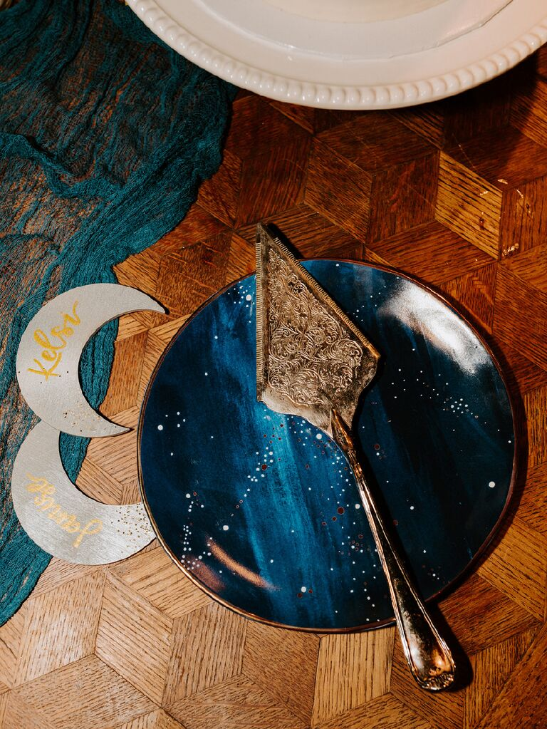 Night sky-inspired serving plates with moon decorations and antique gold serving tool