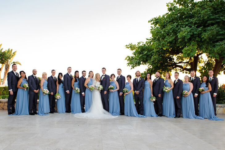 """""""Peter chose a modern-style tuxedo with a slim fit that he knew would look sharp on his groomsmen,"""" the couple says. """"Peter wore a classic black bow tie—while the groomsmen wore neckties—and his grandfather's Navy pin."""""""