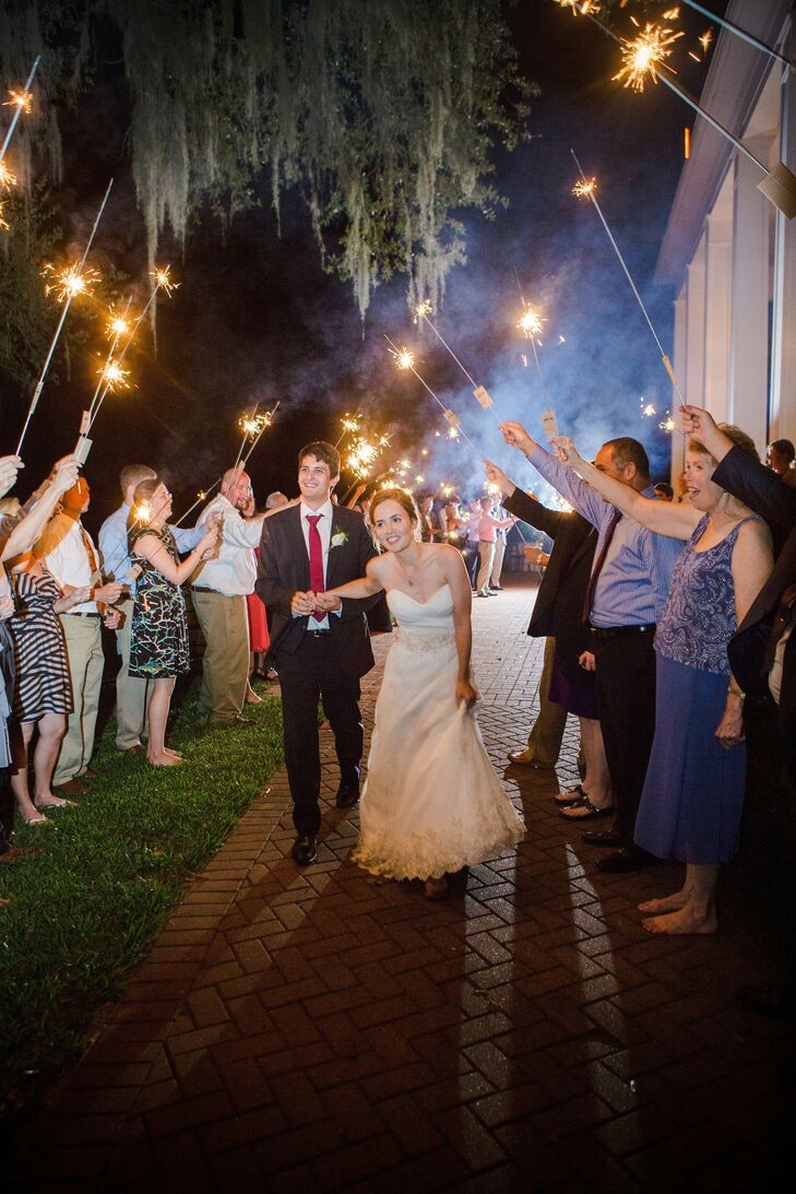 At the end of the celebration, the couple escaped through a tunnel of sparklers.