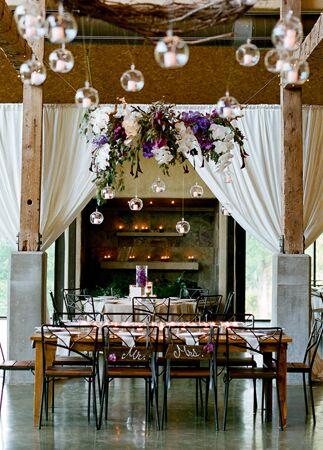 Hanging glass globe wedding decor: Q Weddings / TheKnot.com