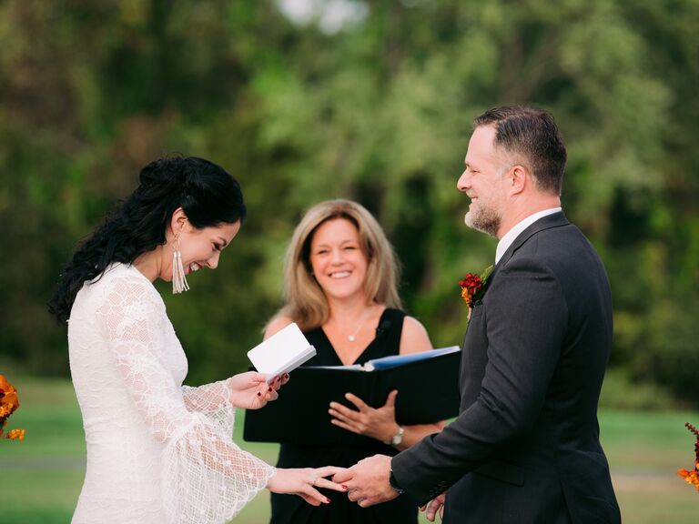 Couple exchanging vows laughing