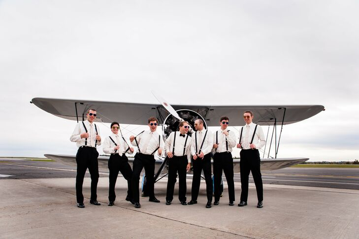 Groomsmen took the opportunity to pose on the airport runway in front of a small propeller plane in their matching suspenders.