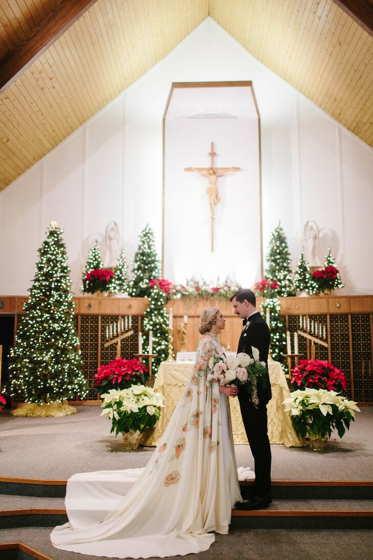 Winter Wedding Ceremony Filled With Christmas Trees and Poinsettias