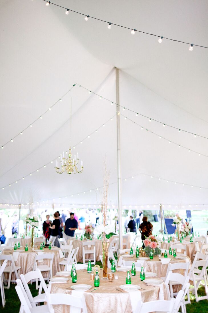 Vintage gold chandeliers hung from the top of the white tent, adding a touch of glam to the reception decor.