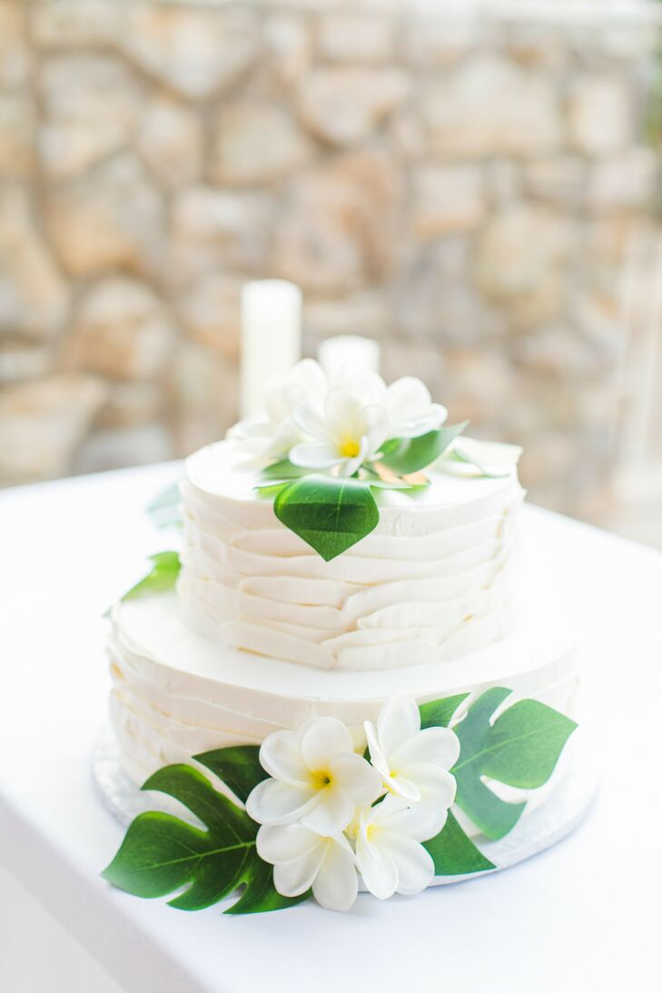 Tropical Wedding Cake with Plumeria and Monstera Leaf Decorations
