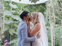 Couple kiss at wedding ceremony