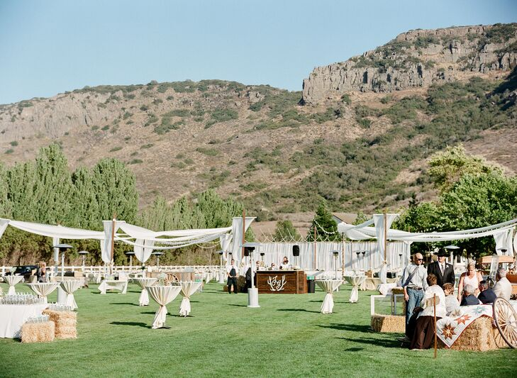 The cocktail hour took place outdoors between the ceremony and reception sites. Guests sipped on signature drinks like the Blondie, a lemon drop cocktail and the Tall, Dark and Handsome, a whiskey and coke, while a bluegrass band played lively tunes.