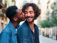 Man kissing boyfriend.