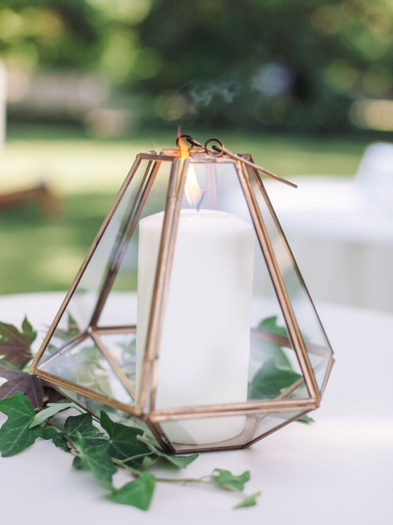 how to honor loved one at wedding candle in gold geometric terrarium