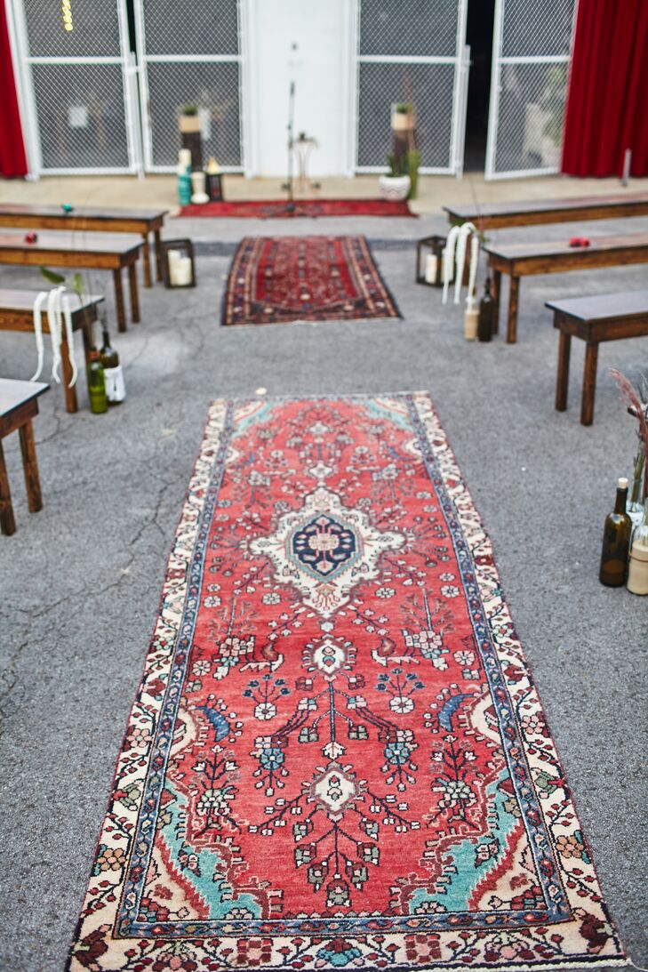 Custom red velvet curtains and Persian rugs lining the aisle added a luxurious touch.