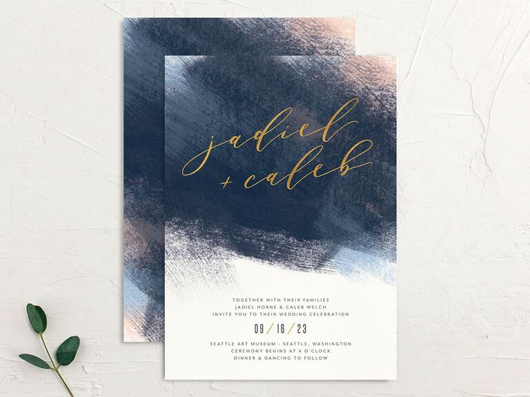 Abstract brushstroke wedding invitation with couple's names in gold