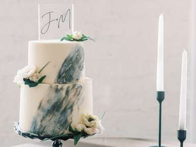 Marble-inspired caked with acrylic topper