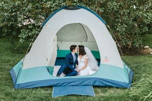 Couple Sharing Kiss in Tent During Backyard Wedding in Reading, Massachusetts