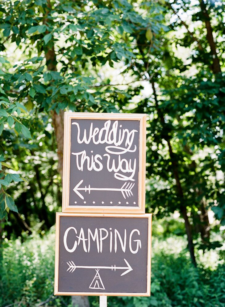 Simple chalkboard signs helped direct guests to the wedding site—35 heavily wooded acres of property owned by Nate's parents.