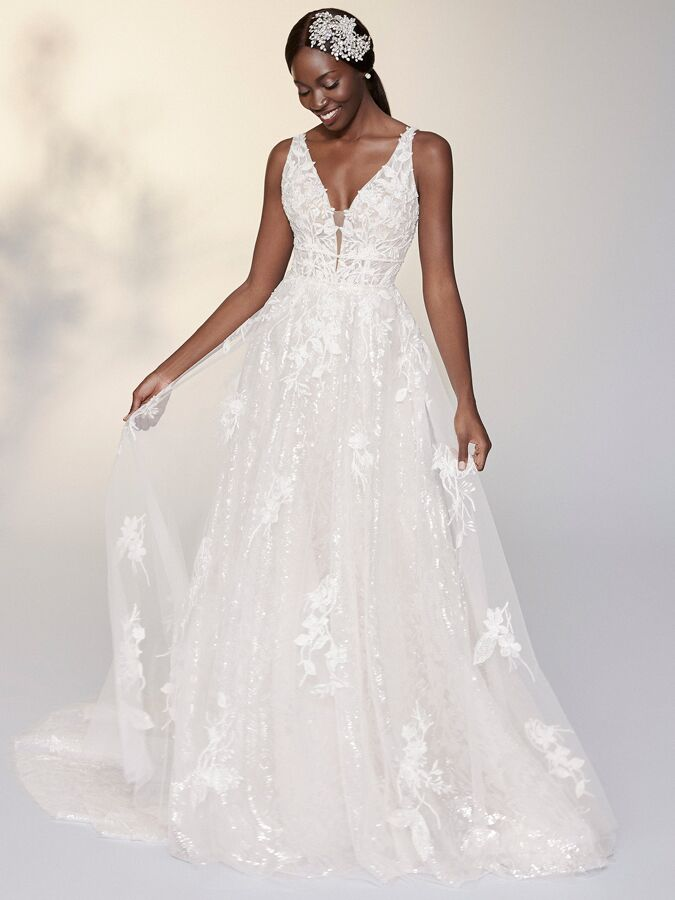 Justin Alexander Signature A-line wedding dress with sequined underlay
