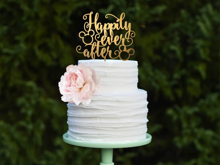 'Happily ever after' in loopy gold script and Mickey Mouse ear decals