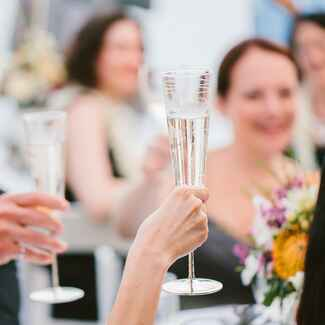 Champagne wedding toast at outdoor Hawaii reception