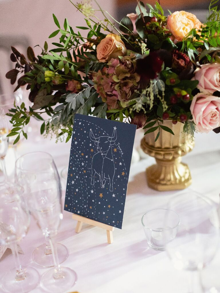 Constellation table number at celestial-themed wedding reception