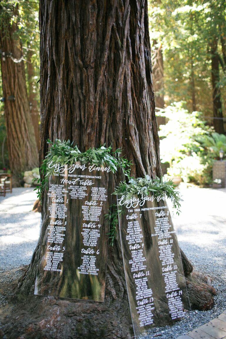 Acrylic seating chart for rustic woodsy wedding