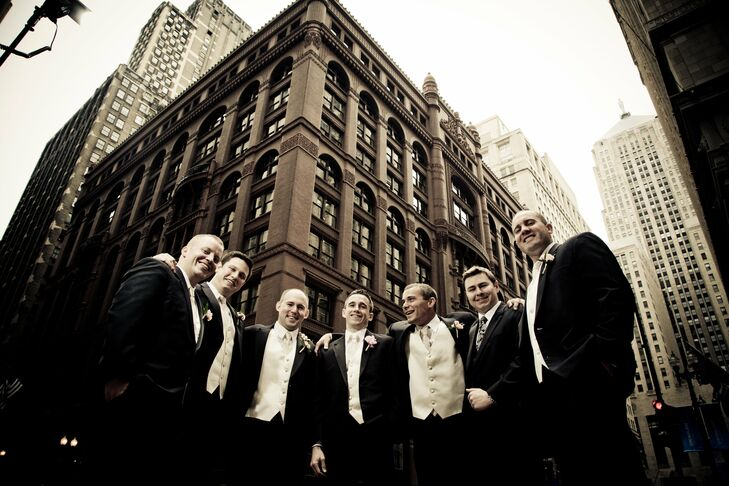 The groomsmen wore Calvin Klein tuxedos as they posed for a quick photo op in downtown Chicago.