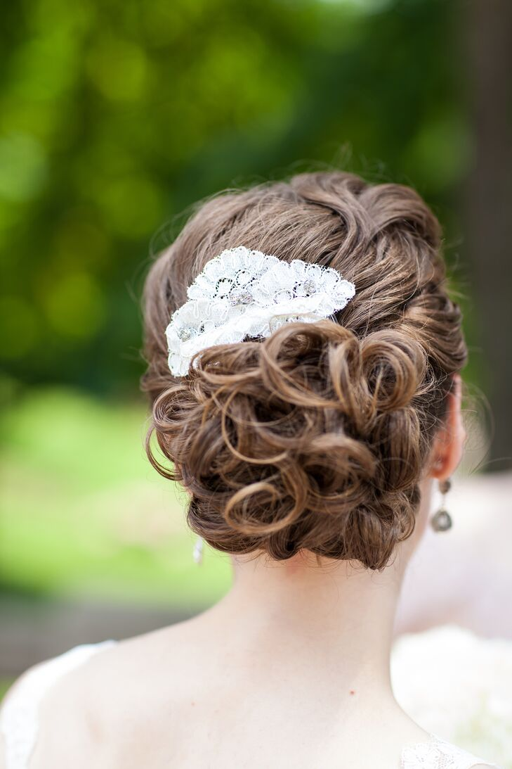 Sharon's curly updo was pinned in place with a handmade white lace comb made by Sharon's mother in law.