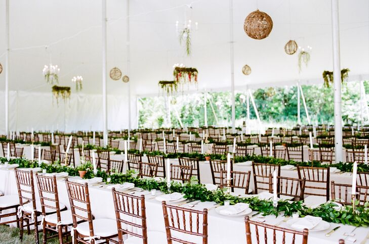 The ceiling of the tent was decorated with handmade floral chandeliers and brown twine balls with twinkling lights inside.
