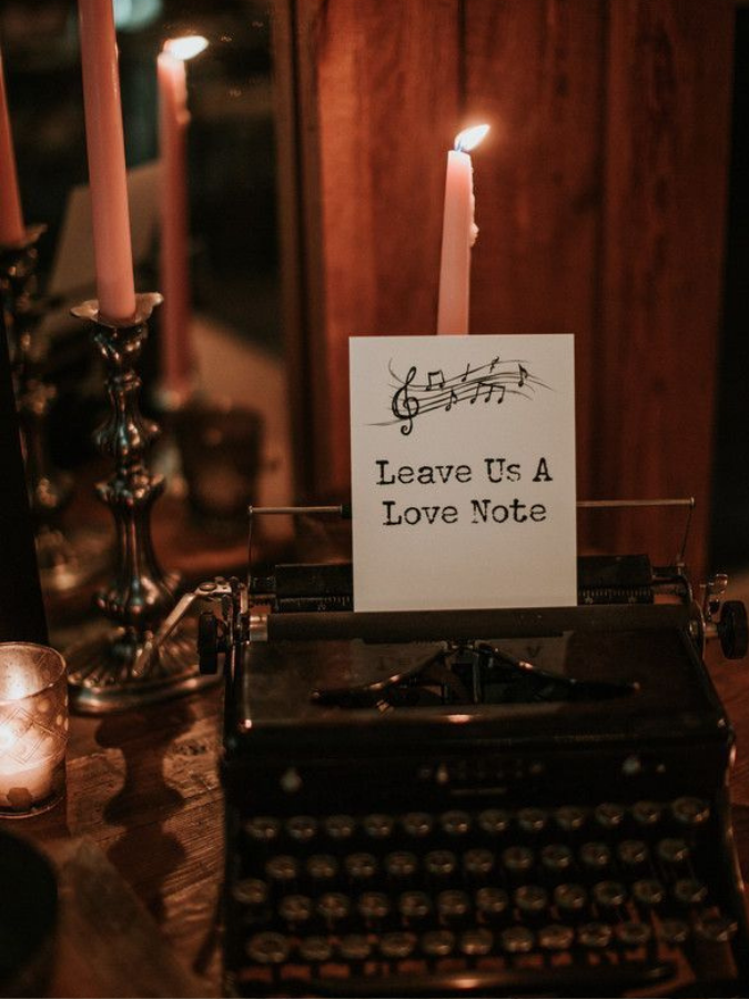 typewriter surrounded by taper candles