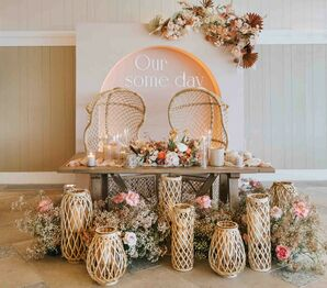 Boho Sweetheart Table with Woven Lanterns and Wicker Chairs