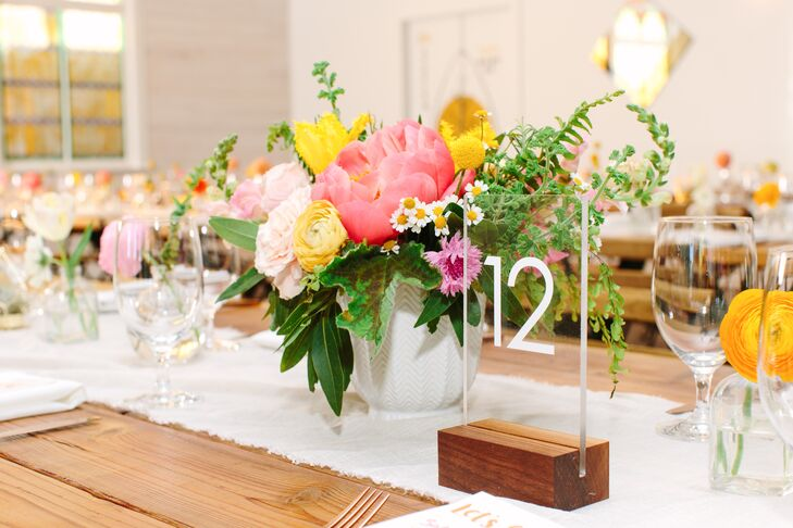 Bright Centerpiece with Crespedia and Ranunculus and Acrylic Table Number