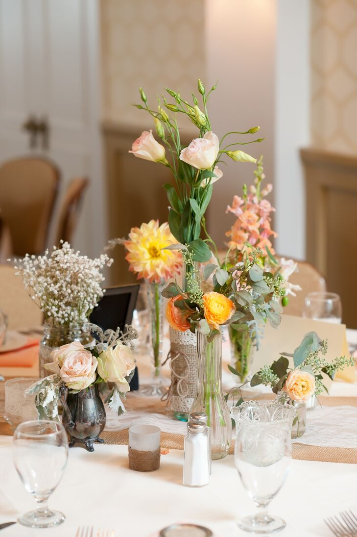 Lori collected various glasses and vases throughout the wedding planning for the centerpieces.