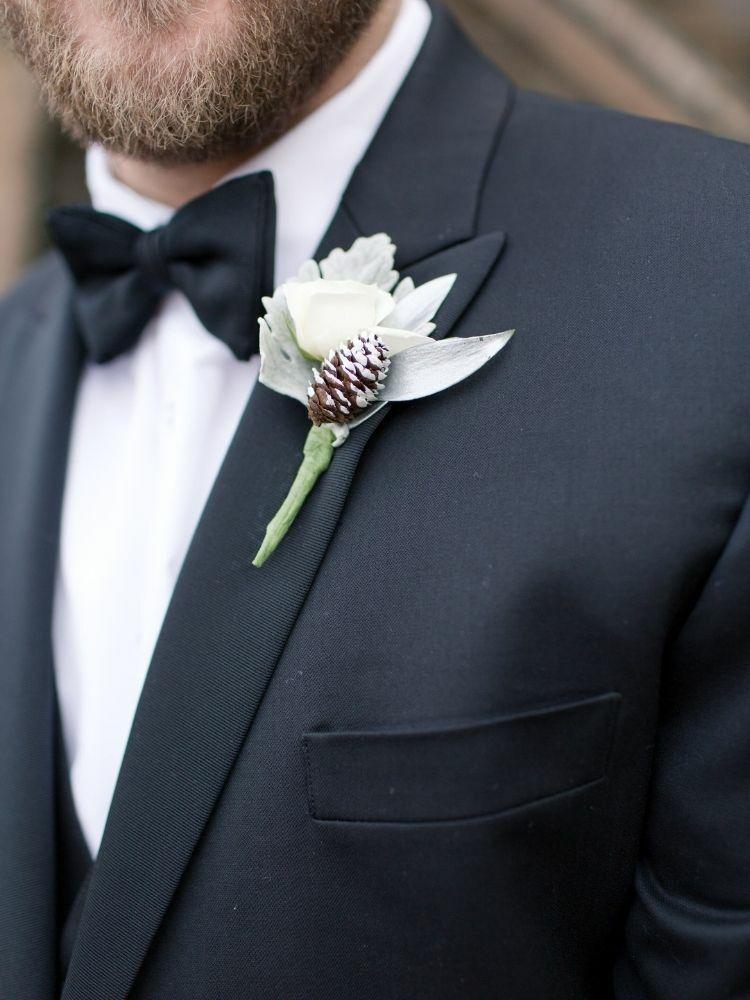 pinecone boutonniere on black tux lapel