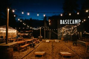 Casual Reception with Picnic Tables, String Lights and Cornhole