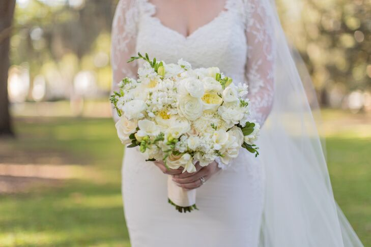 """Amanda wanted her wedding to be filled with lush white and green flowers and carried a full bouquet of peonies and garden roses. """"Kato Floral Designs was beyond amazing,"""" says Amanda. """"They were probably my favorite vendor from the Savannah area that I worked with!"""""""