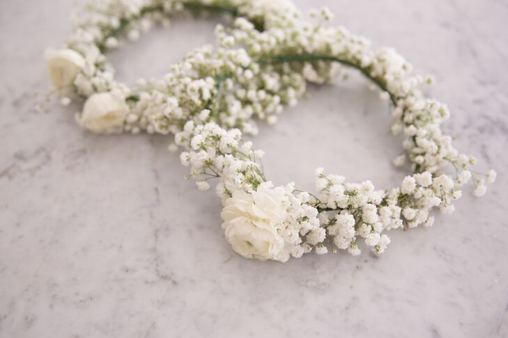 Flower girls wore simple green and white flower crowns made with baby's breath and a single ranunculus bloom.