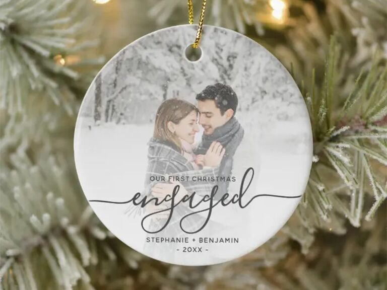 Circle ornament with personalized photo background and 'Our First Christmas Engaged' in black calligraphy