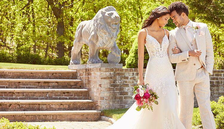 bride lying in Morilee wedding dress