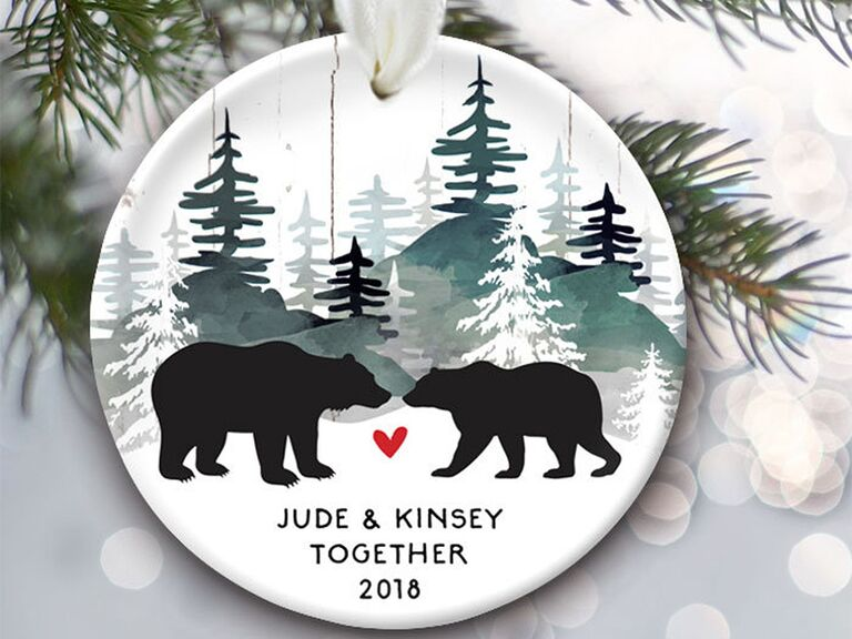 Circle ornament with two black bears and forest background, red heart and personalized names