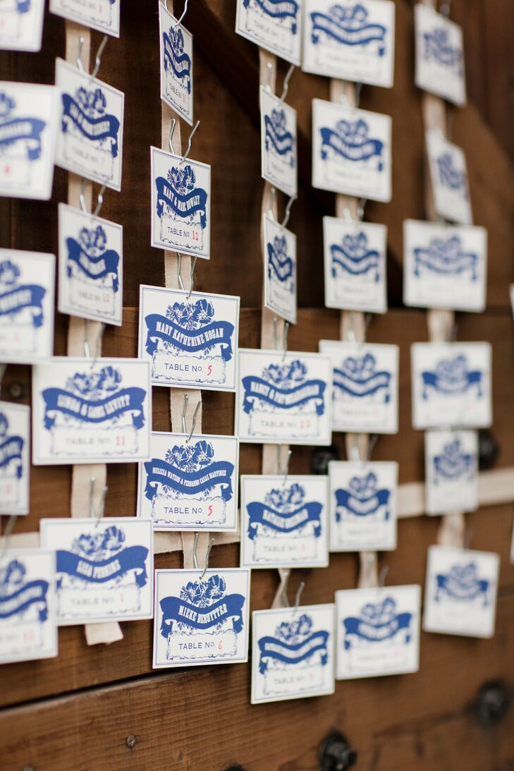 The vintage letterpress escort cards were draped across the barn door and greeted guests as they entered the reception.