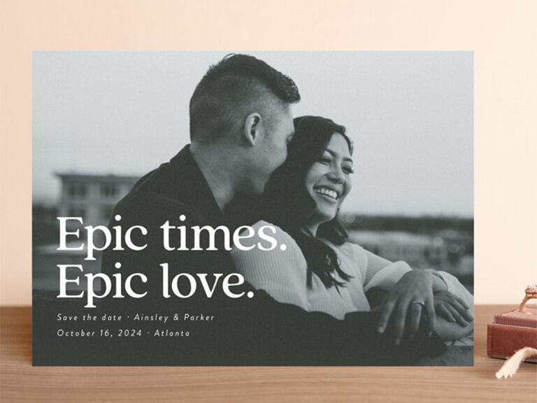 Grayscale personalized photo background with 'Epic times. Epic love.' in bold white type