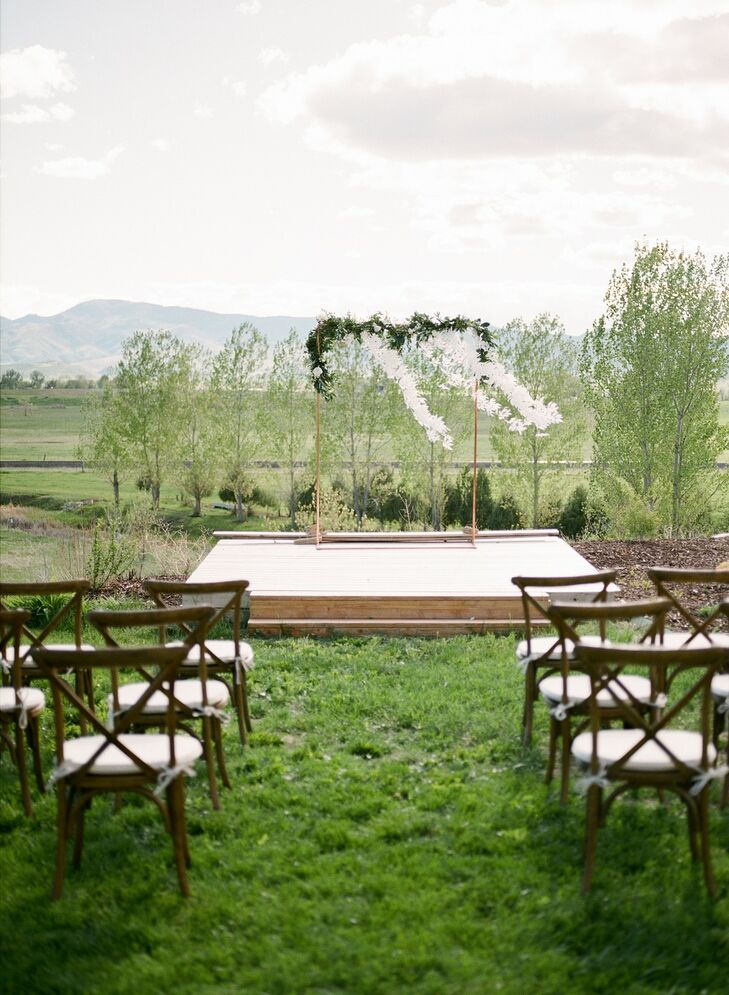 Casual, Rustic Ceremony Site with Wedding Arch and Mountain Backdrop
