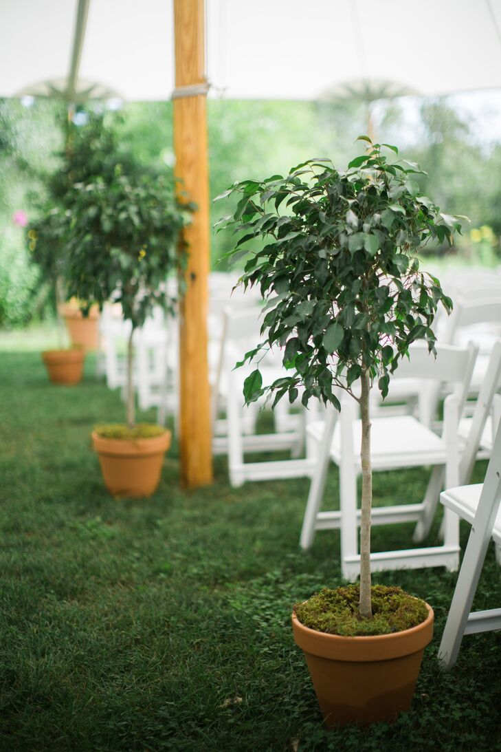"""The ceremony was held under a sailcloth tent on the Seth Bird House lawn, overlooking the Winvian gardens and grounds. To let the beauty of the sentiments and the setting shine, Arianne and Adam chose simple yet strong decorative touches to bring the ceremony space to life. where Arianne and Adam shared vows they'd written themselves. """"In keeping with our love of summertime foliage, we lined the aisle with small potted ficus trees. They were inspired by Kate Middleton and Prince William's wedding ceremony decor,"""" Arianne says."""