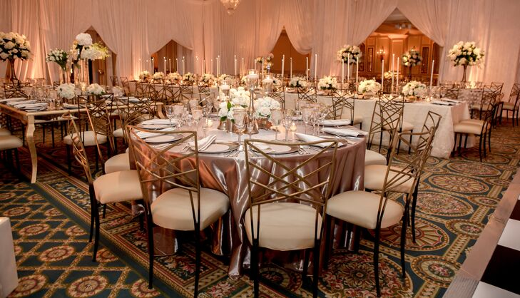 Dining tables at the reception were covered with metallic linens in champagne and ivory, which matched the gold frame chairs.